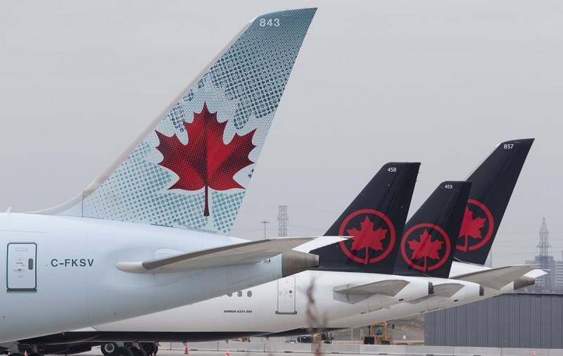 Air Canada aircraft tails lined up on the east side of the airport apron at Pearson International Airport.